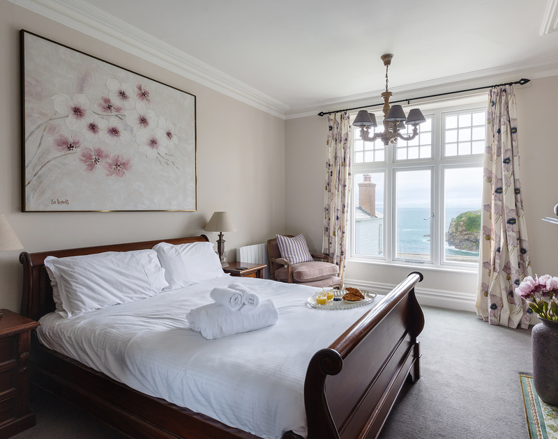 The masterbedroom of Folly 2, with kingsize double bed and lovely sea views