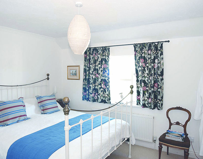 One of two bright, king size bedrooms in Marbeachow, a self catering holiday house in Tredrizzick near Rock in North Cornwall.