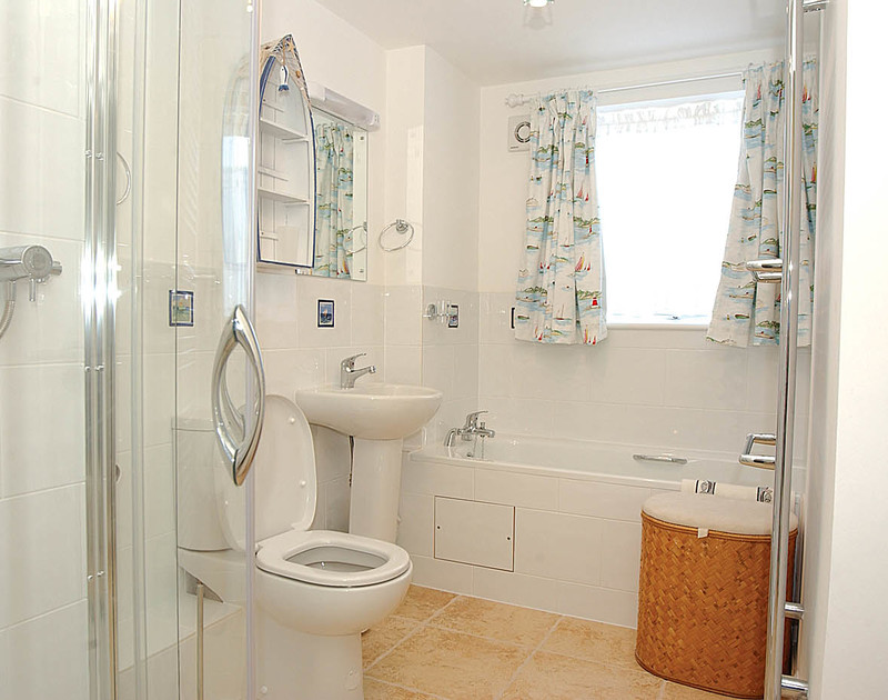 The nautically themed main bathroom of Malindi, a chalet style holiday house at Polzeath, North Cornwall