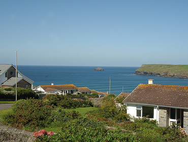 The sea views out to Pentire Point from Badgers Cliff, a self catering holiday house to rent in Polzeath, Cornwall.