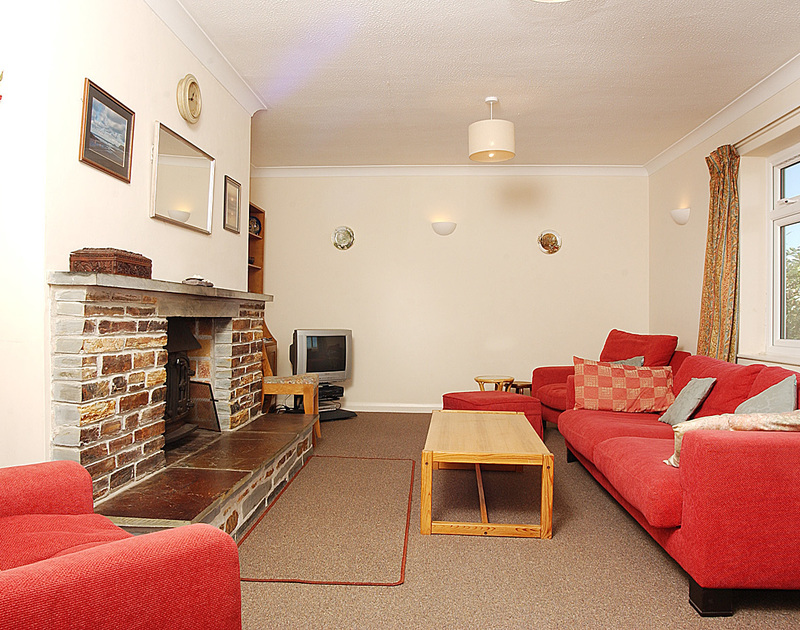 The sitting room in Badgers Cliff, a self catering holiday rental in Polzeath, Cornwall.