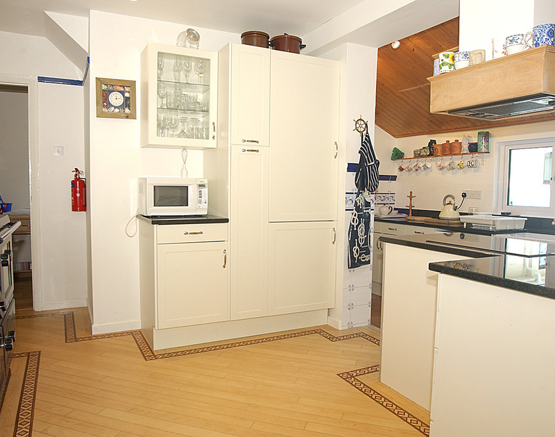 The well-equipped kitchen at Brookfield, a holiday house in Rock, Cornwall, with plenty of storage cupboards.