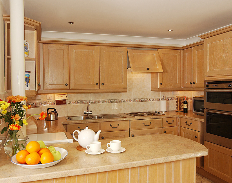 The homely, well-equipped kitchen of Guelder Rose, a self-catering holiday house in Rock, Cornwall