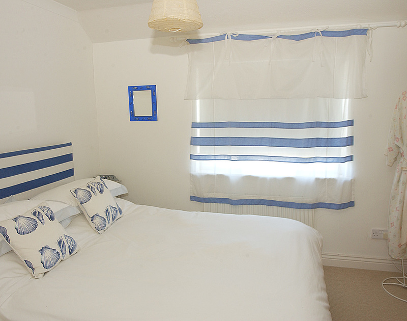 The maritime themed double bedroom in Marbeachow, a self catering holiday house in Tredrizzick near Rock in North Cornwall.