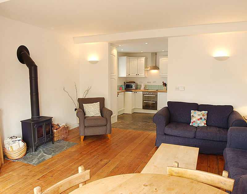 Open plan sitting room through to the kitchen at Stowaway, a self catering holiday rental in Port Isaac, Cornwall.