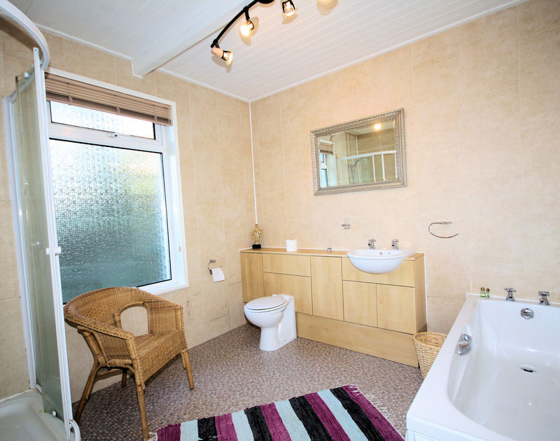 The bath and shower room of Seaspray, a holiday house to rent in Polzeath, North Cornwall