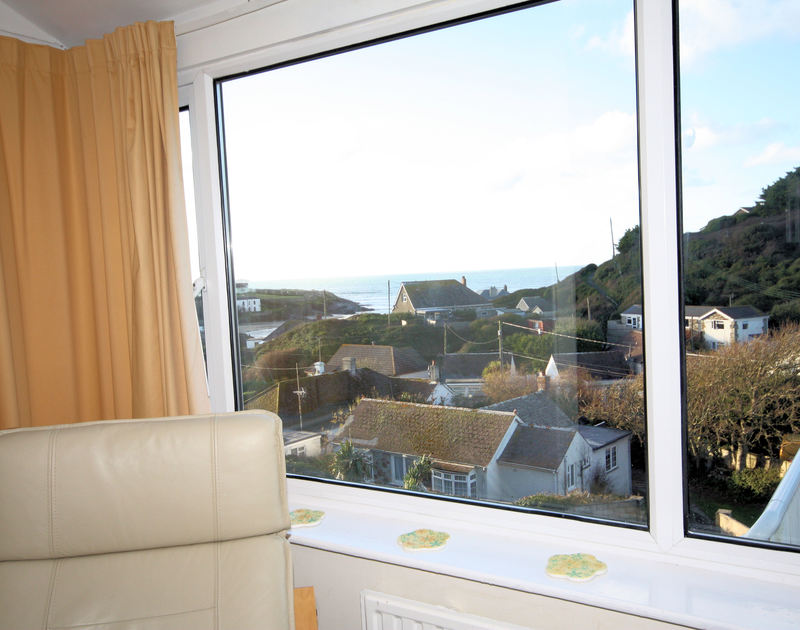 Watch the tide roll in and out from Seaspray, a coastal holiday rental in Polzeath, Cornwall