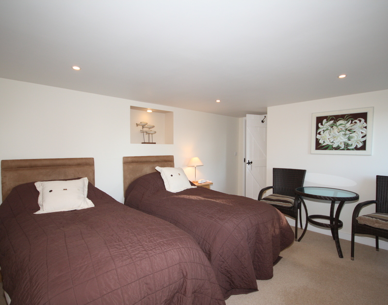 A twin bedroom in Sea Cottage,a self catering holiday rental on the Camel Estuary in Rock in North Cornwall.