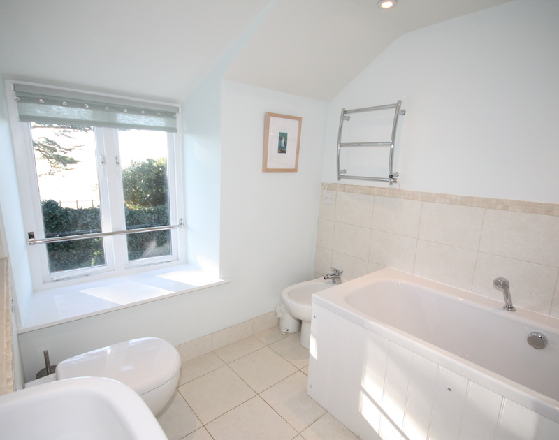 One of three modern bathrooms in Sea Cottage, a self catering holiday rental in Rock, Cornwall.