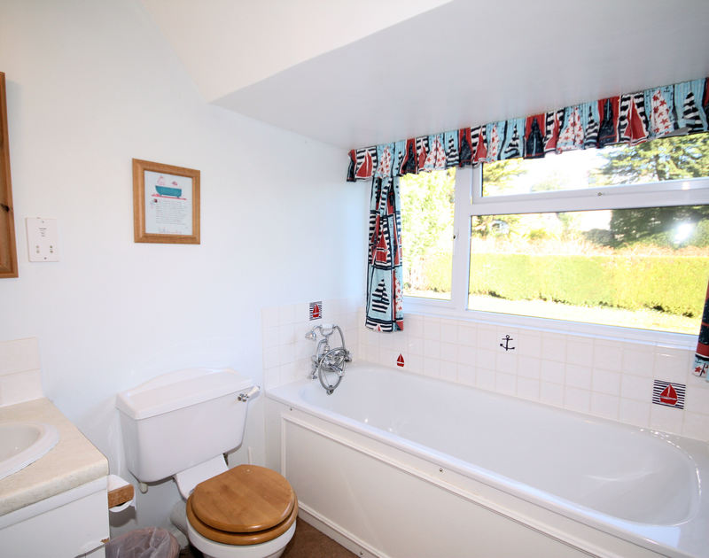 One of two bathrooms in Tregillan, a holiday rental that will allow one pet, set in pretty gardens close to the sea in Rock, North Cornwall.