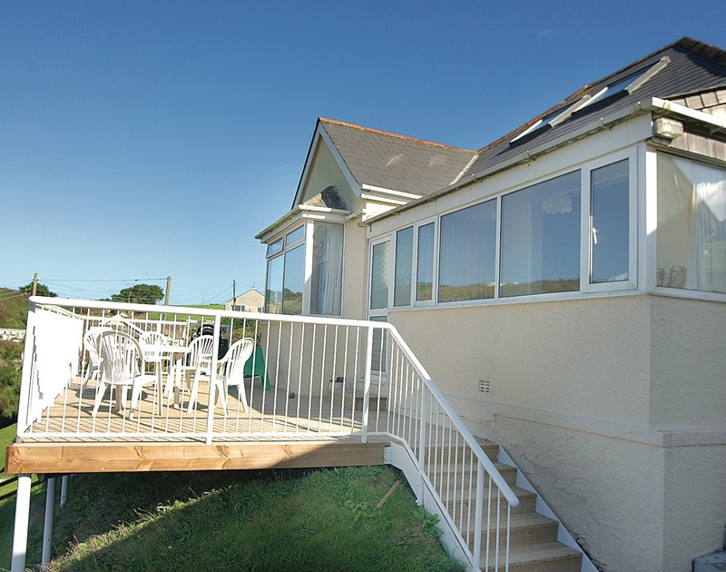 Enjoy the lovely views from the elevated balcony of Seaspray, a self-catering holiday house in Polzeath, Cornwall,