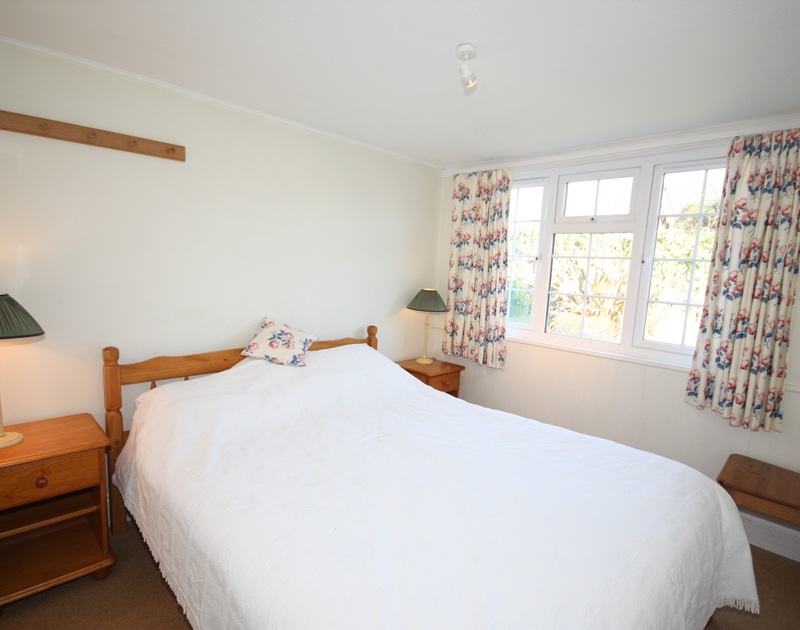 The restfully decorated double bedroom at Lanhay, a self-catering holiday house in Rock, North Cornwall