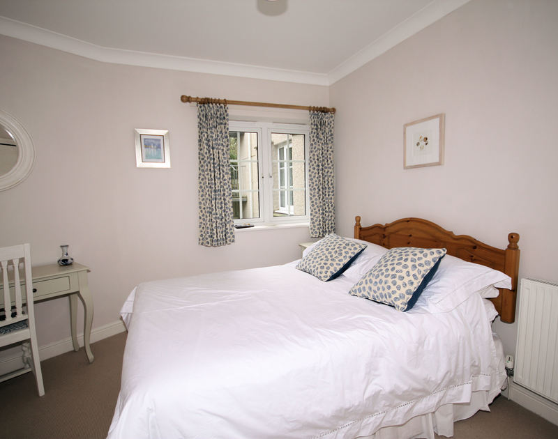 The double bedroom at Bodare 2 self catering holiday home in Daymer Bay in North Cornwall.