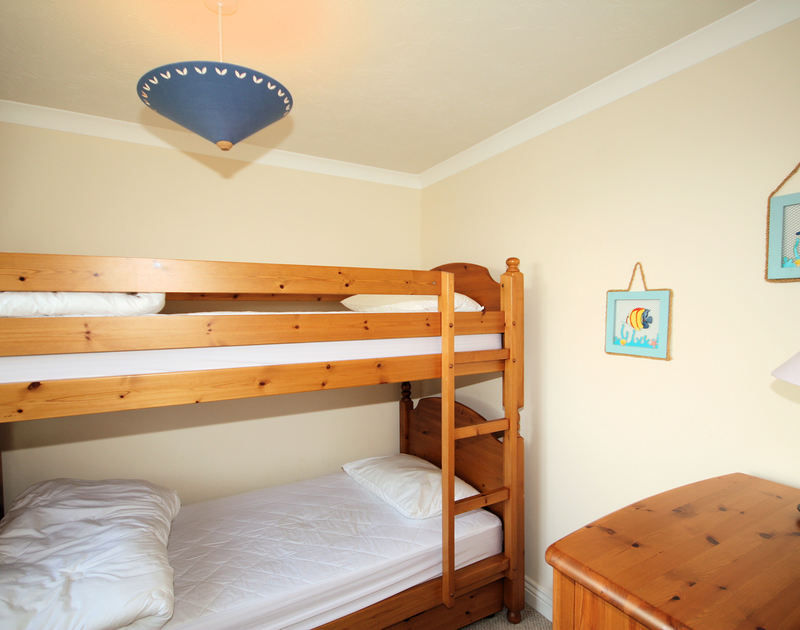The bunk bedroom in Tresow a self catering holiday house to rent in Tredrizzick, Rock, Cornwall.