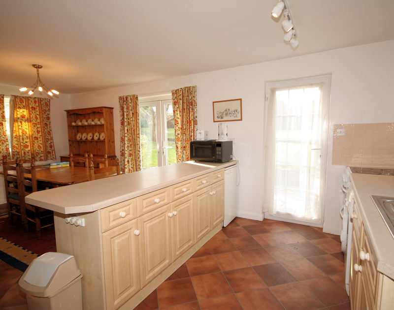 White House's open plan kitchen/diner with its ample work surface, this holiday house is near Rock, Cornwall.