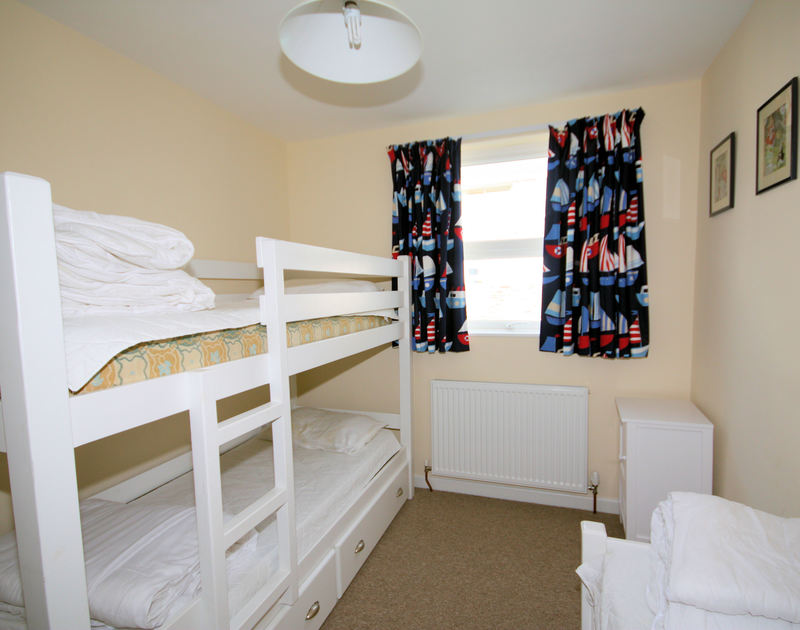 The bunk bedroom with extra single bed at Slipway 9, self-catering holiday house in Rock, Cornwall