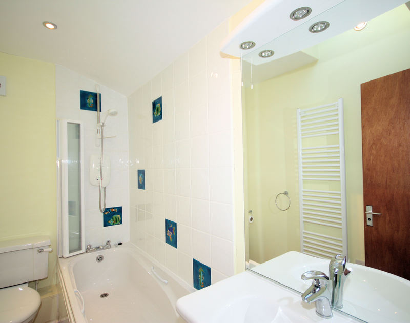 One of three bright bathrooms in Trevic, a holiday house to rent by the sea and beach at Polzeath , North Cornwall.