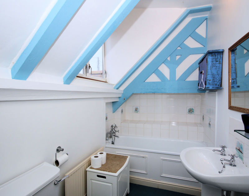 The characterful bathroom at Pemberton, a self catering holiday house to rent on the coast at New Polzeath in North Cornwall.