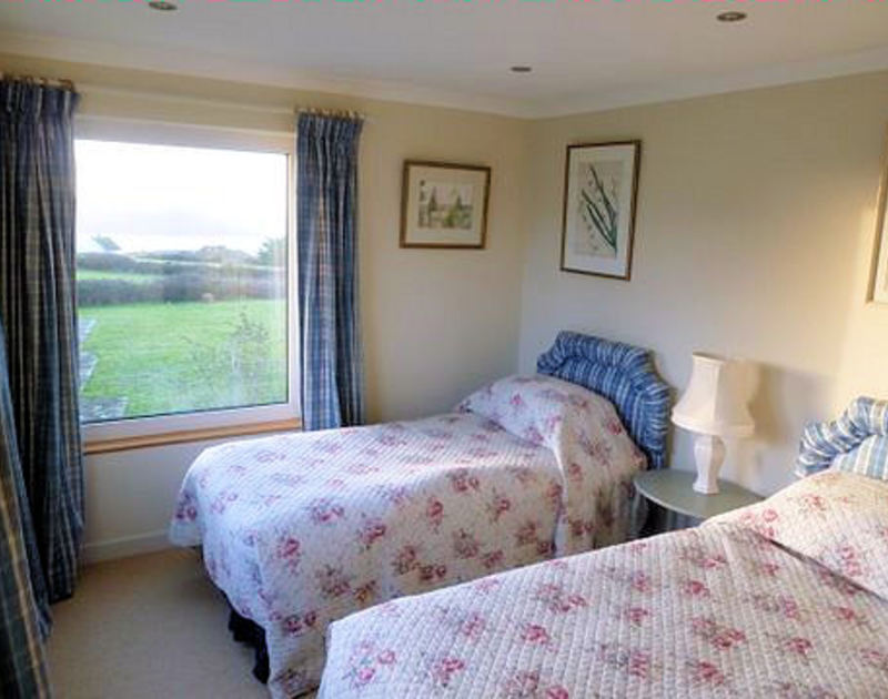 A twin bedroom at Tristan, self-catering holiday house near Daymer Bay, Cornwall