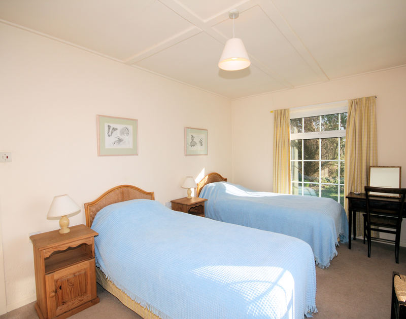A bright,spacious twin bedded room in Thalassa, a self catering holiday home in Daymer Bay, Cornwall.