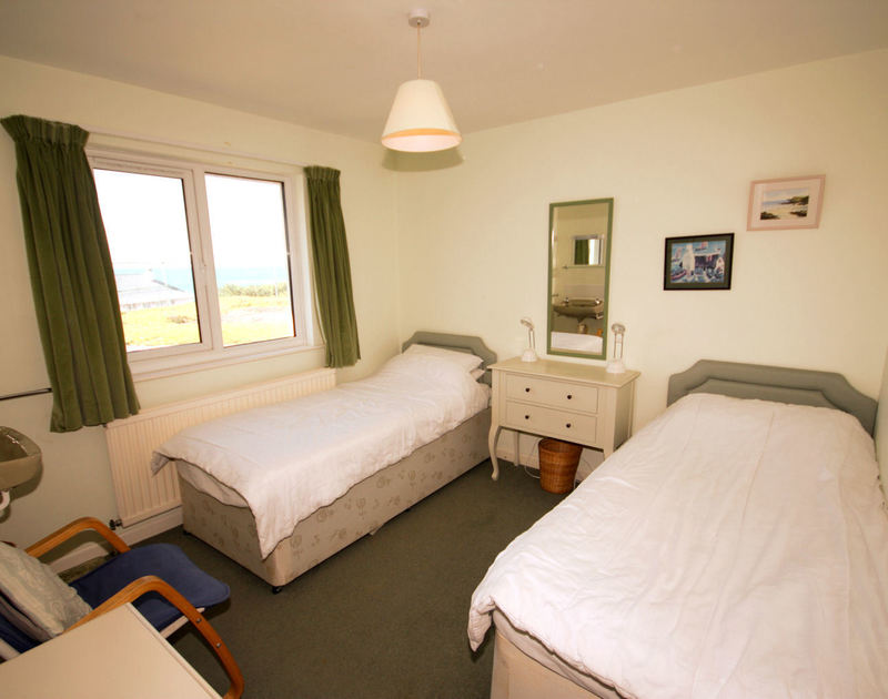 Twin bedroom with coastal and sea views at Upper Gren, holiday house near Daymer Bay, Cornwall