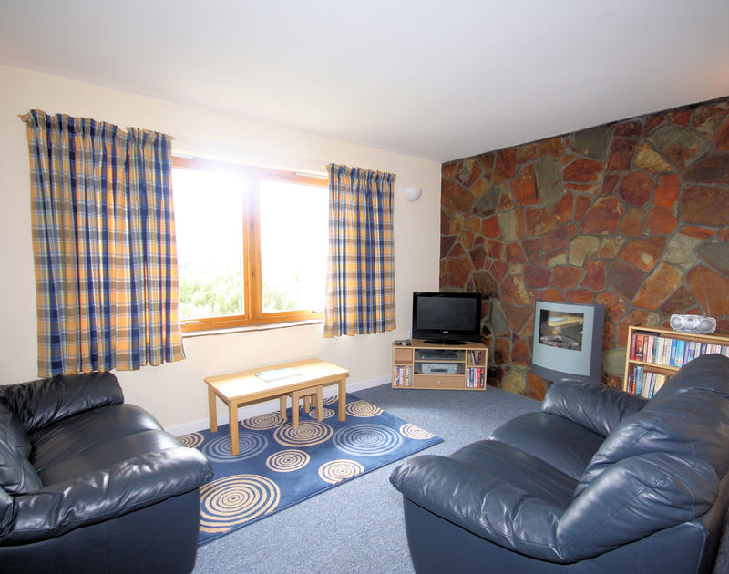 The lounge in Polzeath Court 4, a self catering holiday apartment in New Polzeath on the North coast of Cornwall.