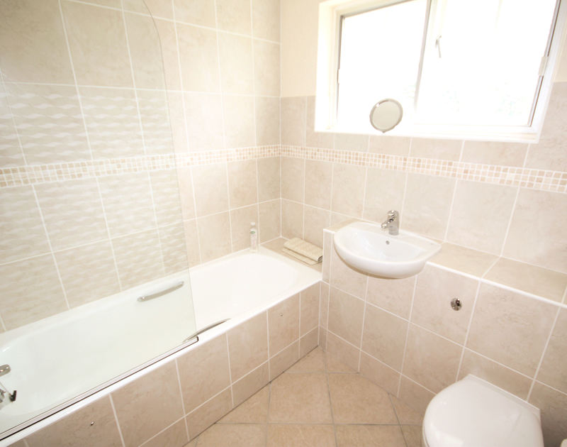 The fully tiled, modern bathroom of Guelder Rose, a holiday rental in Rock, North Cornwall