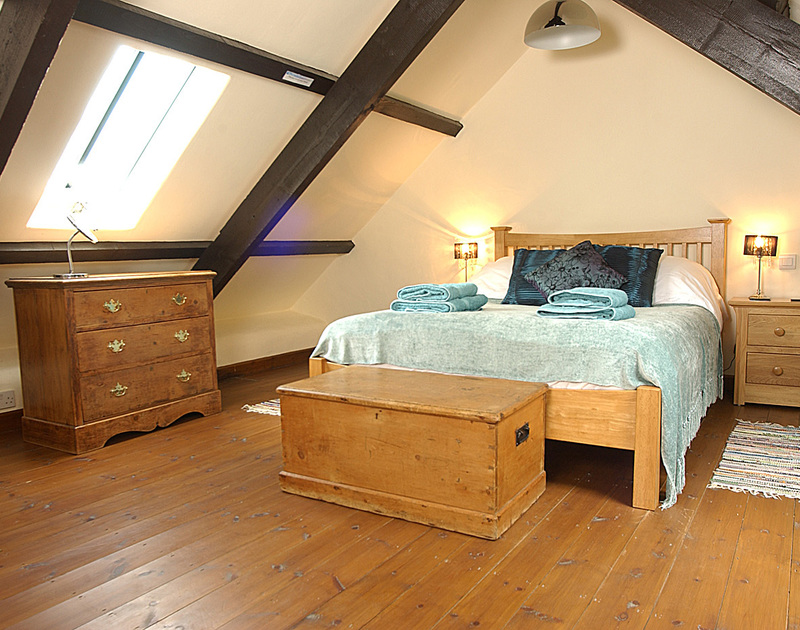 The romantic mezzanine bedroom at Little Tides, a holiday cottage to rent in Rock, Cornwall
