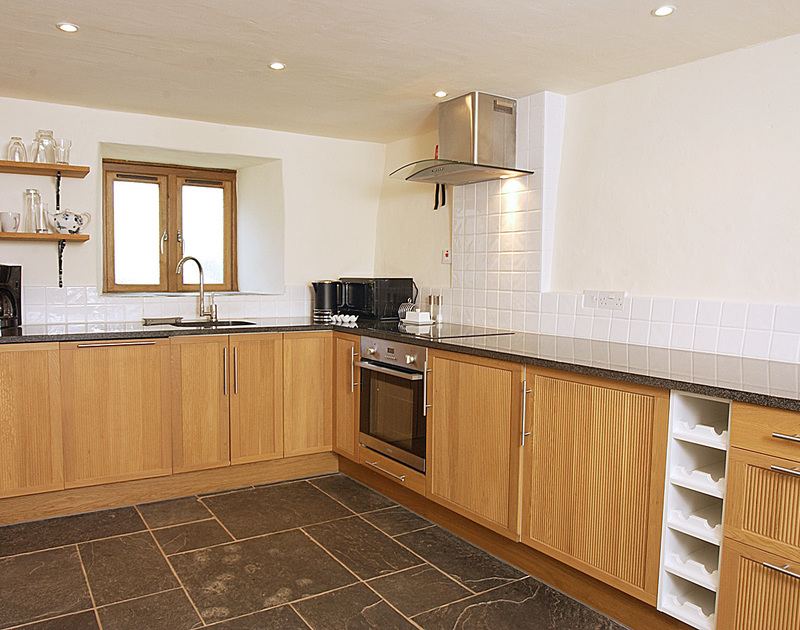 The smart, stylish kitchen at Little Tides, a self-catering holiday let in Rock, Cornwall