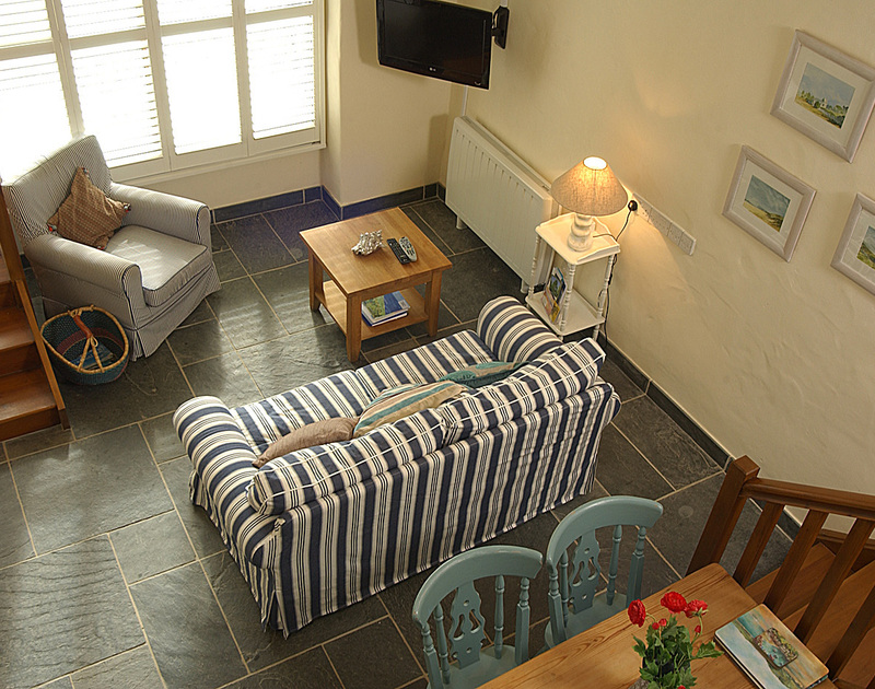 View of the sitting room from the mezzanine bedroom of Little Tides, a holiday cottage in Rock, Cornwall