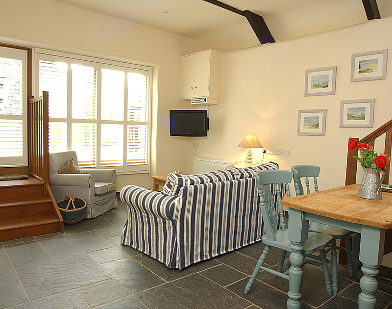 Step down into the open plan lounge/diner at Little Tides, a self-catering holiday rental in Rock, Cornwall