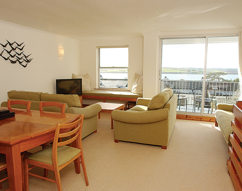 The sitting room with far reaching views over the Camel Estuary at Slipway 15, a holiday cottage to rent in Rock, North Cornwall.