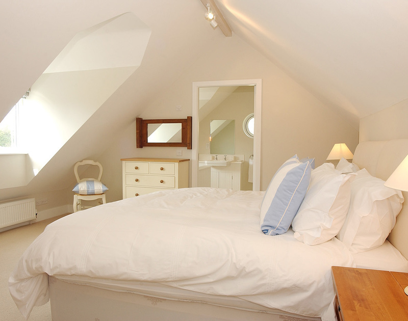 One of the comfortable en-suite bedrooms in Medrose 2, a self catering holiday house to rent in Rock, North Cornwall.