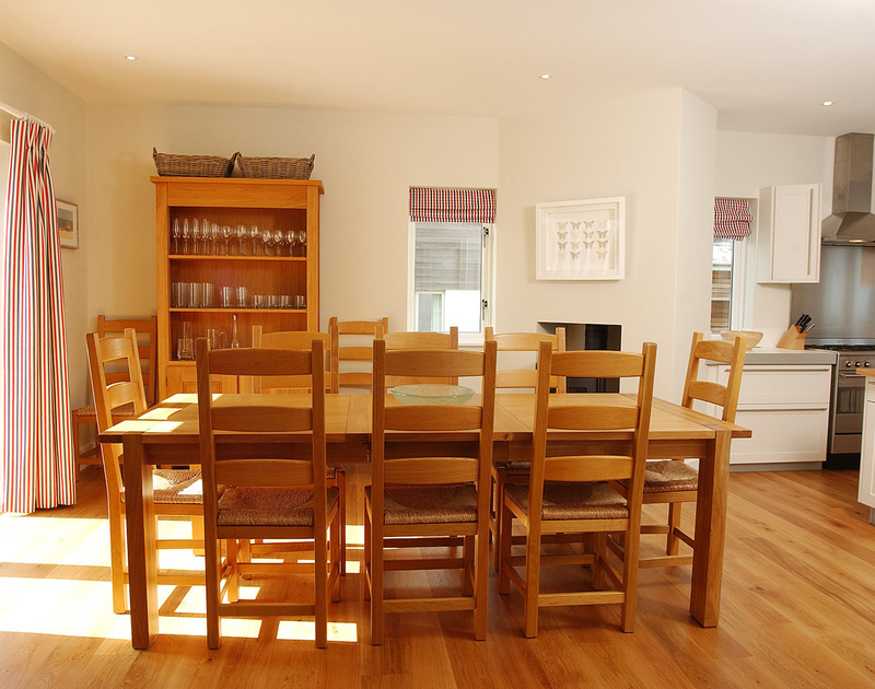 The elegant dining room in Medrose 2, a self catering holiday house to rent in Rock on the North Cornish Coast.