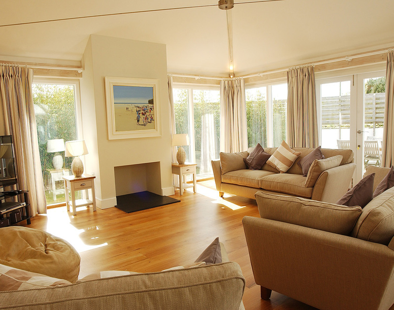 The comfortable living room in Medrose 2, a self catering holiday house in Rock, North Cornwall.