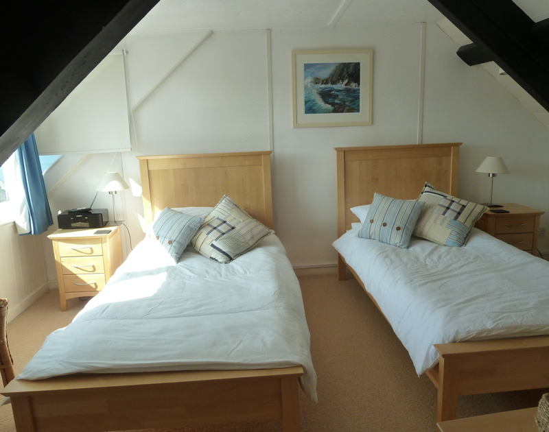 Pretty twin bedroom with sea views at Tremanon, a self catering holiday cottage to rent in picturesque North Cornwall.