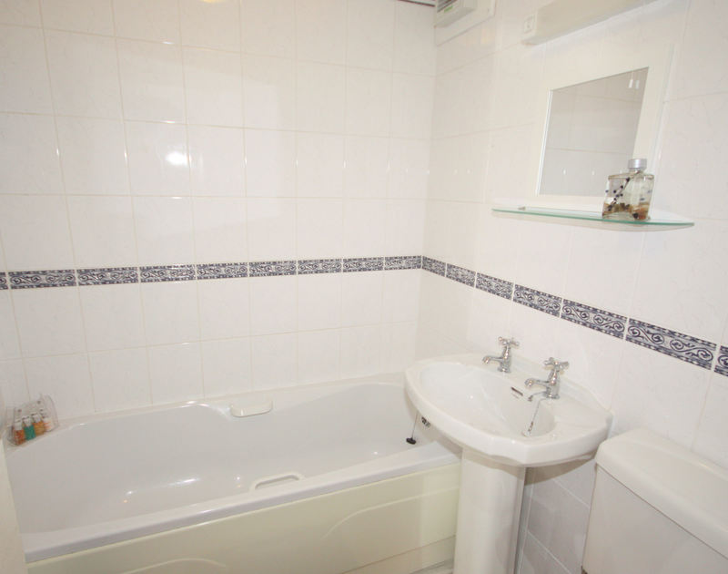 The bathroom of Westward 7, a self-catering holiday apartment in Polzeath, North Cornwall