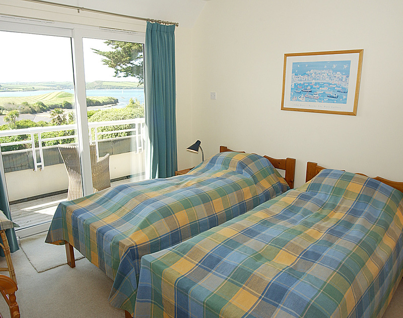 Beautiful views over Porthilly beach and across the Camel estuary from a bedroom of September Corner, holiday house in Rock, Cornwall