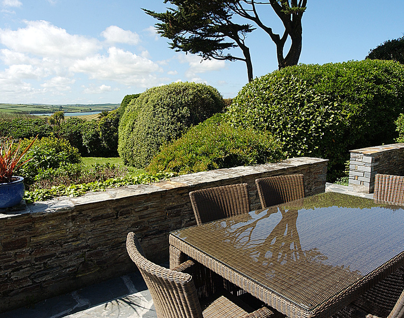 The view of the garden and Camel estuary from the elevated patio of September Corner, holiday rental in Rock, Cornwall