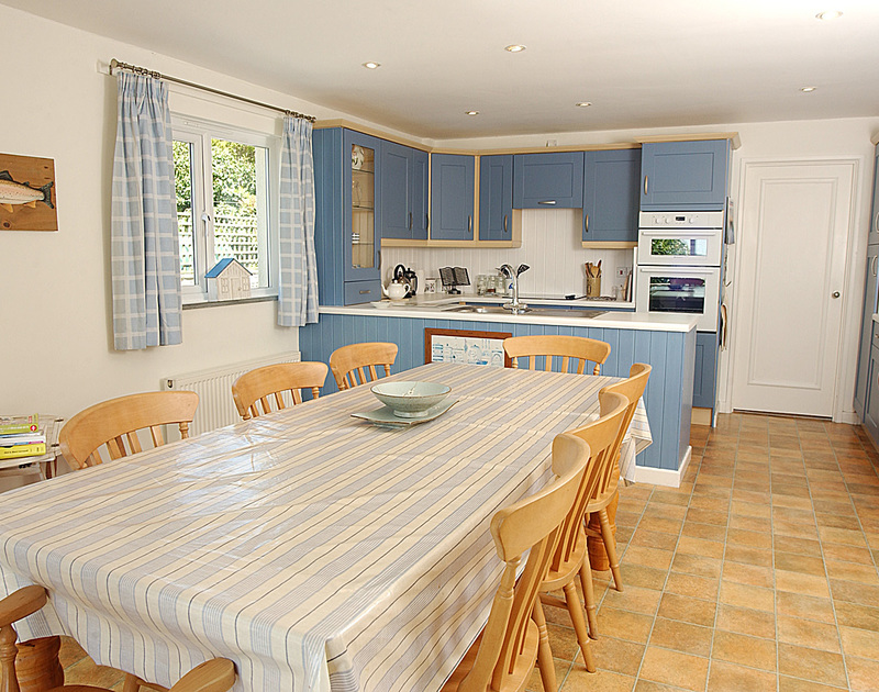 The attractively decorated kitchen of September Corner, a holiday rental in Rock, Cornwall