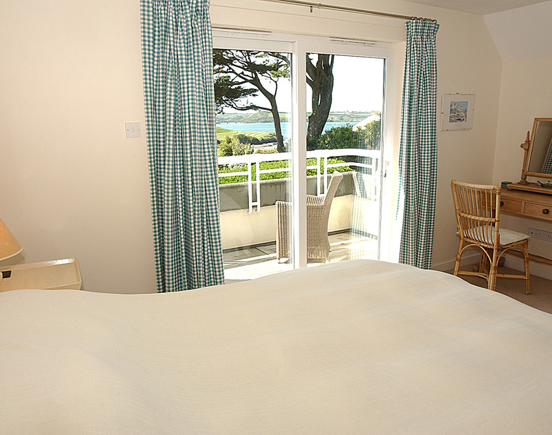 Views across the Camel Estuary from a bedroom and balcony at September Corner, holiday rental in Rock, Cornwall