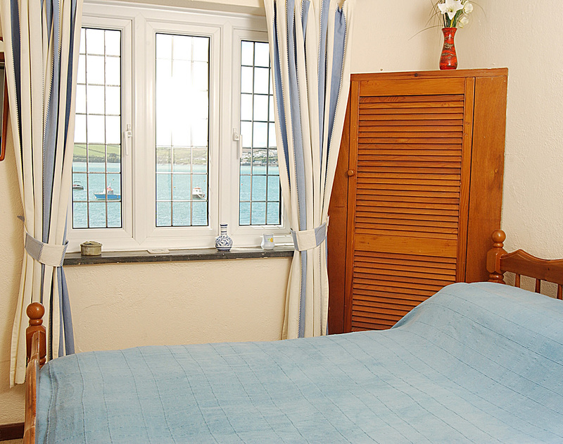 Double bedroom overlooking the beautiful Camel Estuary at Cocklebar, holiday rental in Rock, Cornwall
