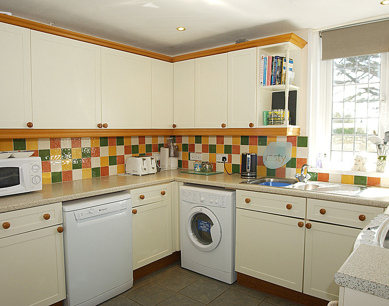 The well-equipped kitchen of Cocklebar, a well-located holiday rental in Rock, Cornwall