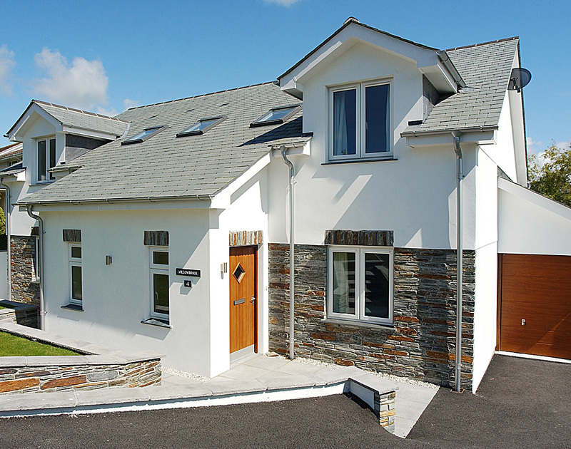 The smart exterior of Willowbrook, a self-catering holiday rental in Rock, Cornwall with attractive stone-facing detail.