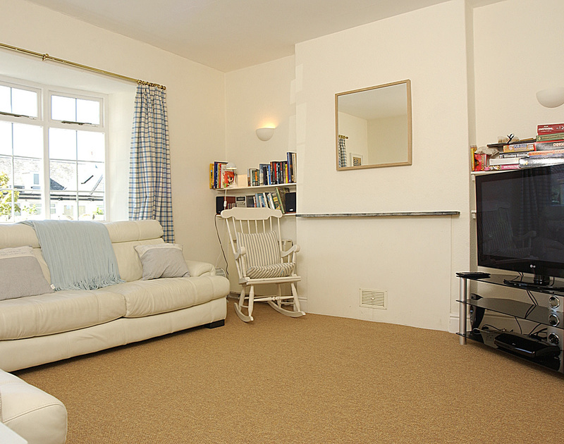The sitting room with a huge flat screen TV in Musters, a self catering, dog friendly, holiday rental in Rock, North Cornwall.