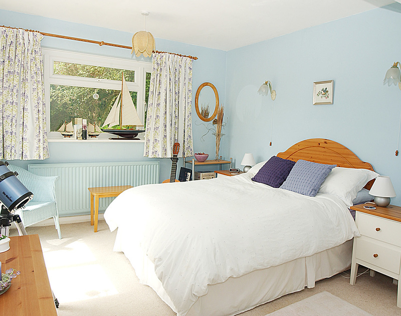 One of two bright, welcoming bedrooms in Little Sands, a self catering holiday rental in Rock, Cornwall.