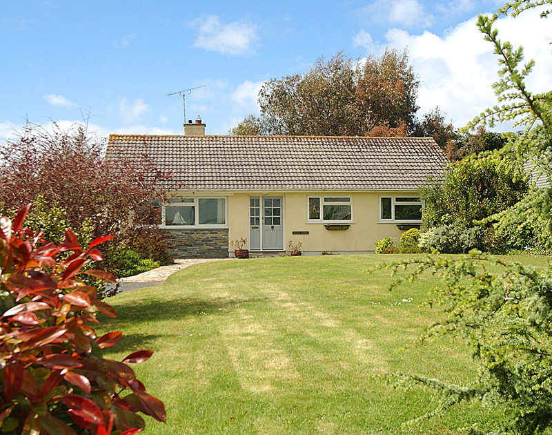 The front view from the lawned garden at Little Sands, a self catering holiday bungalow located in Rock, Cornwall.