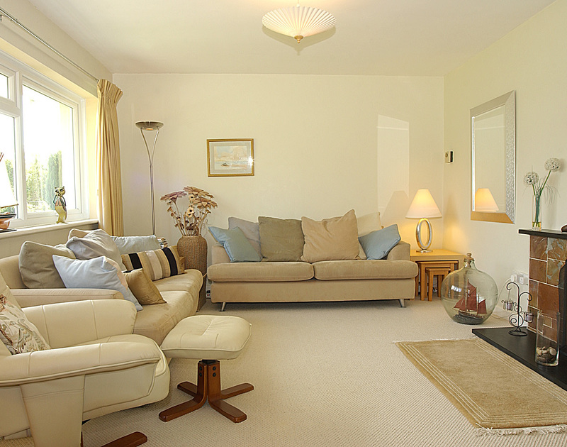 The comfortable and elegant sitting room in Little Sands, a self catering holiday bungalow to rent in Rock, Cornwall.
