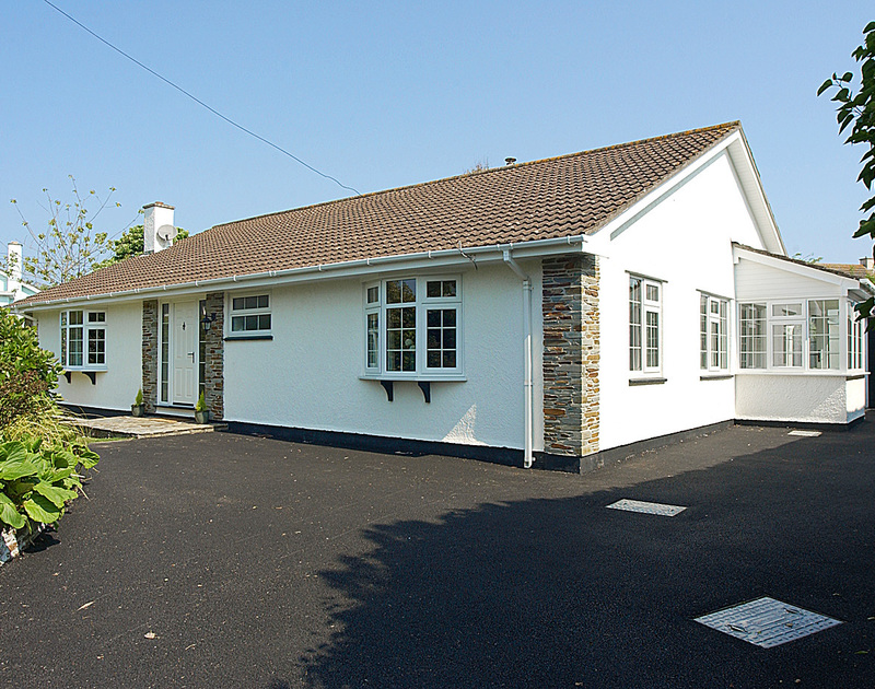 The exterior view of Guelder Rose, a holiday house in Rock, Cornwall, with its spacious driveway.