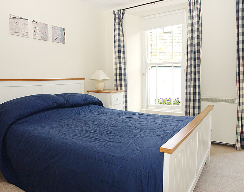 Attractively decorated master bedroom in Brakestone Cottage, Port Isaac, with double bed